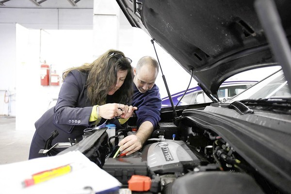 Female owner of collision repair shops